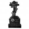 Крест на кладбище c розами